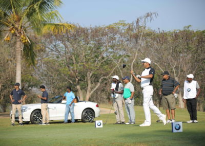 Players teeing off at the BMW Golf Cup Interantional